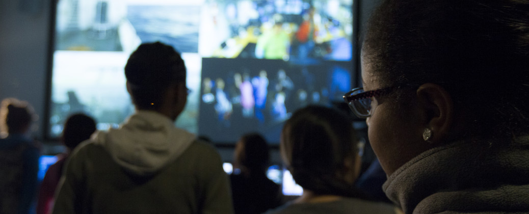 Members of the public watch a live video feed from R/V Endeavor.